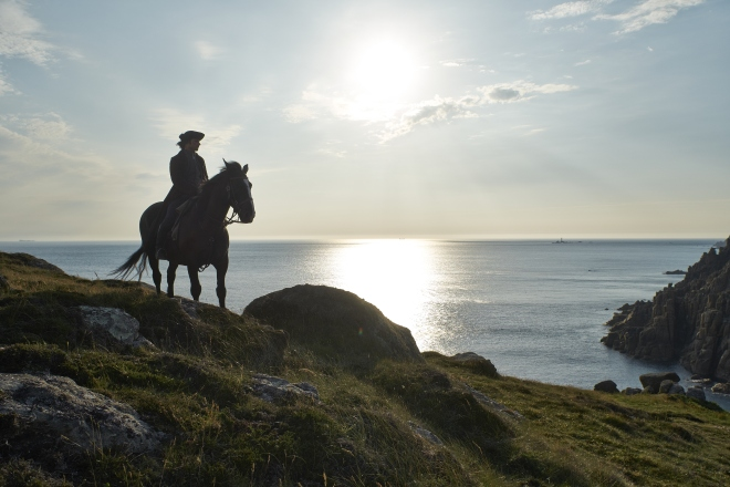Poldark overlooking the cliffs of Cornwall  © ITV plc (ITV Global Entertainment Ltd)